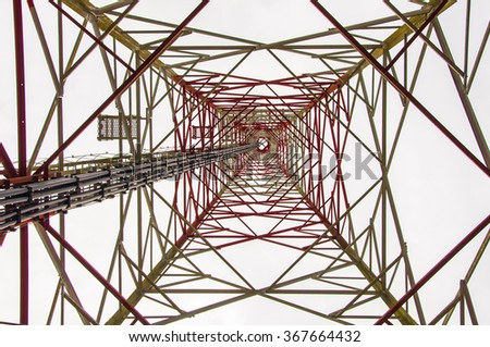 Abstract unusual view from beneath and beside of cellular tower. - stock photo