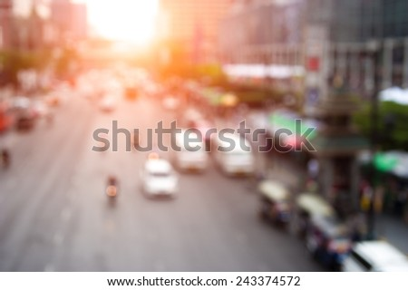 Abstract urban background with blurred buildings and street, shallow depth of focus - stock photo