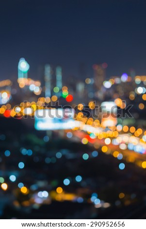 Abstract urban street light bokeh, defocused background - stock photo