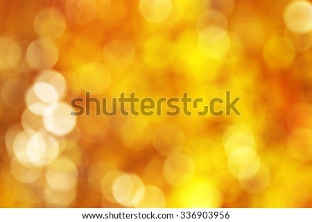Abstract vibrant golden, yellow, orange circle bokeh background texture