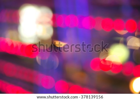 Abstract vibrant red and purple bokeh over dark background - stock photo
