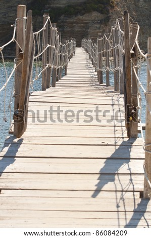 Abstract view at wooden beach bridge
