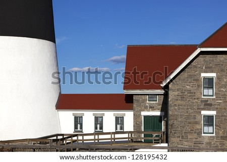 Abstract view between the house and the lighthouse.  Fire Island Lighthouse, Long Island, New York. - stock photo