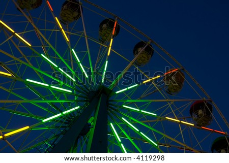 Abstract view of a colorful ferris wheel at night - stock photo