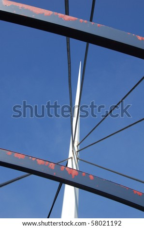 Abstract view of bridge support against a blue sky