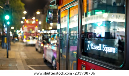 abstract view of bus and traffic in London with street lights at night with bokeh effect - stock photo
