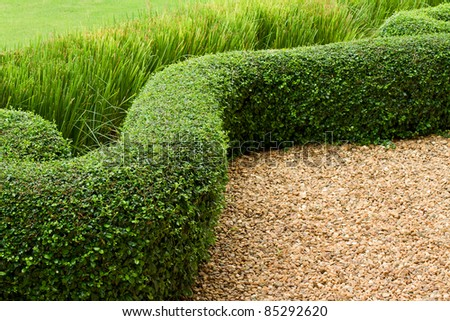 Abstract View Of Green Lawn With Pebbles And Tiles
