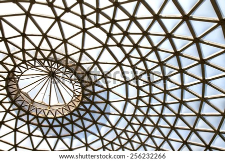 abstract view of metal and glass roof of conservatory - stock photo