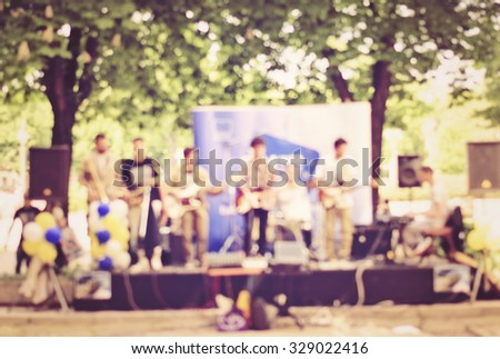 Abstract view of street musicians - stock photo
