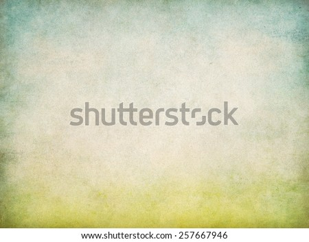 abstract vintage old paper background with green grass and blue sky - stock photo