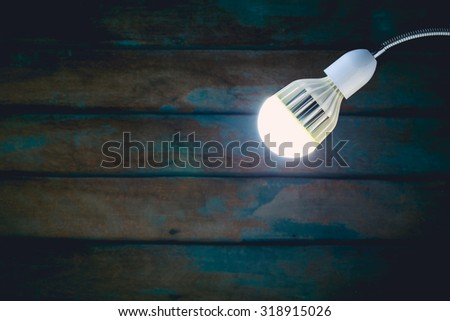 abstract vintage tone of hanging white lamp with old wooden wall background. - stock photo