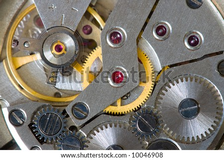 abstract watch mechanism background with gears macro