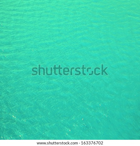Abstract  water background - bright cyan blue and green  sea water may use as background or texture. - stock photo