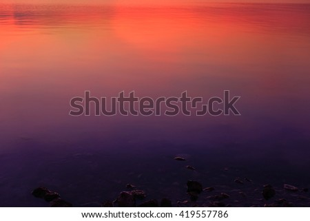 Abstract water texture background with colorful lighting reflection on sunrise:Close up,select focus with shallow depth of field:ideal use for background. - stock photo
