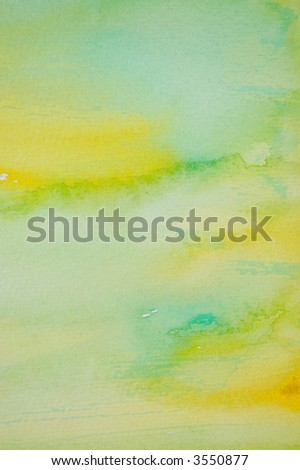 Abstract watercolor background with yellow and green layers on visible paper texture - stock photo
