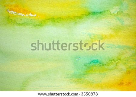 Abstract watercolor painted background with yellow and green layers on visible paper texture - stock photo