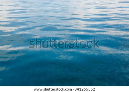Abstract wave reflection on sea water surface - stock photo