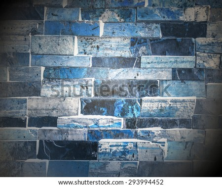 Abstract weathered texture of stained old dark stucco snowy and painted blue, black brick wall background in rural room Grungy frosty blocks of ice stonework glacial retro color architecture wallpaper - stock photo