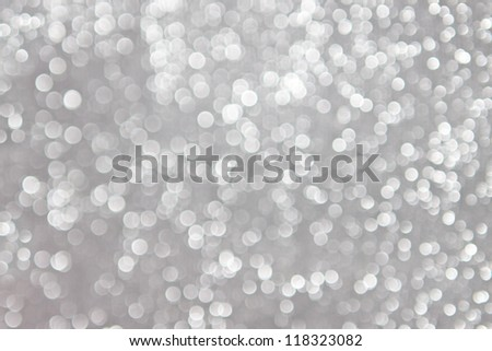 abstract white bokeh lights on grey background - stock photo