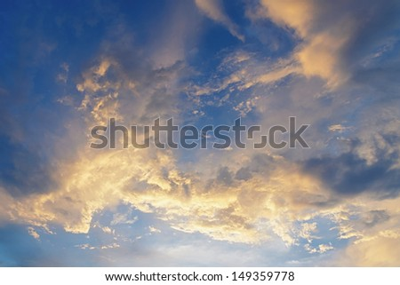 Abstract white clouds on the blue summer sky.