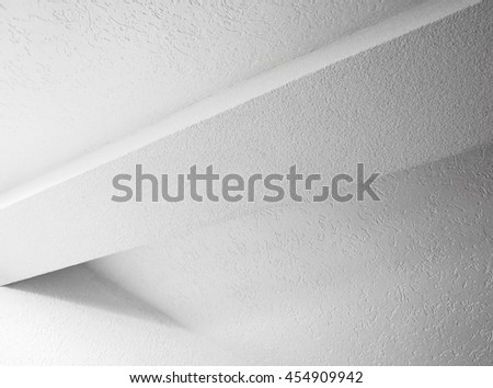 Abstract white interior fragment with beam and walls, black and white photo - stock photo