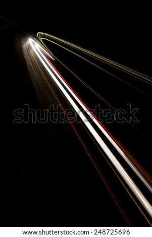 Abstract white rays of light in a car tunnel - stock photo