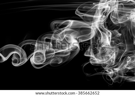 Abstract white smoke on black background.
