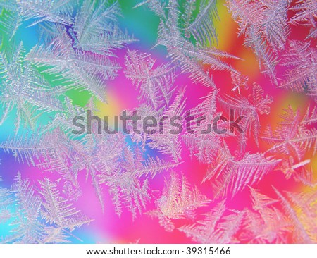 Abstract window frost with rainbow colored background - stock photo