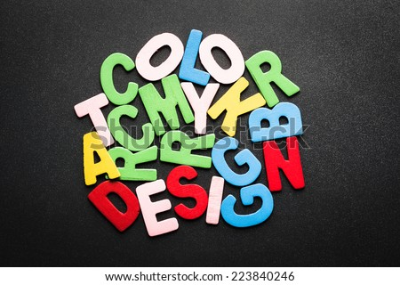 Abstract wood letters on black background, Color design learning concept (CMYK, RGB, COLOR, ART, DESIGN) - stock photo