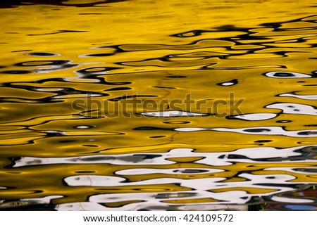 Abstract yellow reflections on the sea. - stock photo