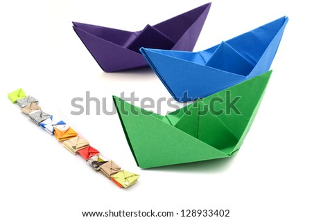 Abstracting on winner,  origami green boat - stock photo