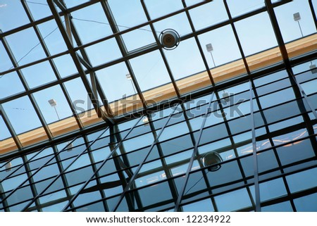 abstraction, transparent ceiling of the modern office building with orange stripe