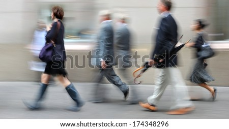 abstrakt image of business people in the street and modern style with a blurred background