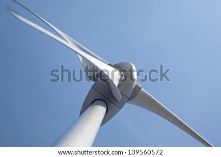 Abtract view of wind turbine with a clear blue sky