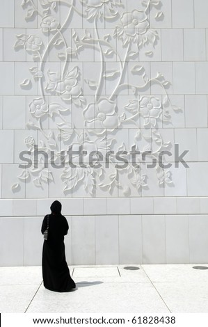 Abu Dhabi Arabian Woman at Sheikh Zayed Mosque - stock photo