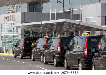 ABU DHABI - DEC 19: Taxis at the Abu Dhabi International Airport. December 19, 2014 in Abu Dhabi, United Arab Emirates - stock photo