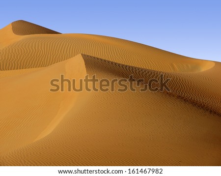 Abu Dhabi desert - changing patterns of the Liwa Desert, which is part of the Rub al Khali Desert or Empty Quarter, straddling UAE, Oman, Yemen and Saudi Arabia - stock photo