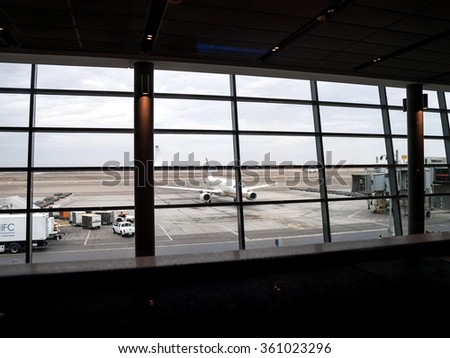 Abu Dhabi International airport, United Arab Emirates - April 27 , 2013: Photography ETIHAD Airlines plane at the airport in Abu Dhabi - stock photo