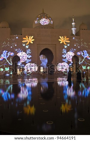 Abu Dhabi Sheikh Zayed Grand Mosque beautifully lit - stock photo