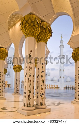 Abu Dhabi Sheikh Zayed Grand Mosque, walkway at sunrise - stock photo