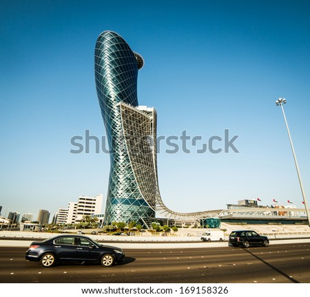 ABU DHABI, UAE - DECEMBER 18: The Capital Gate Tower on the December 18, 2013 in Abu Dhabi, This is certified as the Worlds Furthest Leaning Manmade in the world. - stock photo