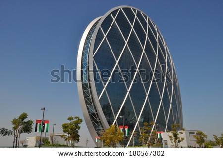 ABU DHABI, UAE - FEB 15: Aldar Headquarters Building in Abu Dhabi, UAE, as seen on Feb 15, 2014. It is the first circular building of its kind in the Middle East. - stock photo