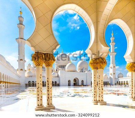 ABU DHABI, UAE - FEB 08: Inner court yard and minaret of the largest mosque in the United Arab Emirates and the eighth largest mosque in the world. Abu Dhabi, UAE - February 08, 2014 - stock photo
