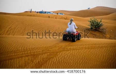 ABU DHABI, UAE - FEBRUARY 01: Desert safari in Dubai, United Arab Emirates. Dune bashing by a 4x4 car is a very popular activity. - stock photo