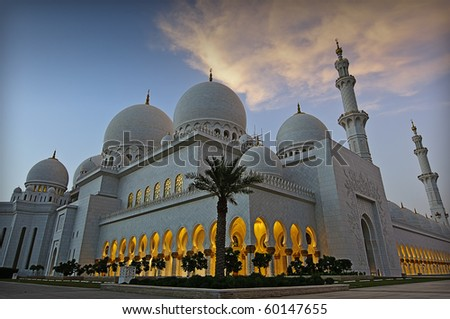 ABU DHABI, UAE - JULY 10:  The Sheikh Zayed Mosque taken in Abu Dhabi on 10th July 2010.  The grand mosque is the eighth largest mosque in the world and houses the worlds largest carpet and chandelier - stock photo