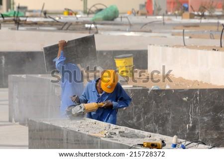 ABU DHABI, UAE - MAR 1: Workers at the Sheikh Zayed Mosque in Abu Dhabi. March 1, 2010 in Abu Dhabi, United Arab Emirates - stock photo