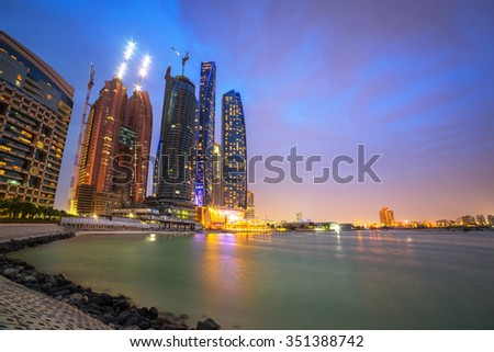 ABU DHABI, UAE - MARCH 25, 2014: Etihad Towers buildings in Abu Dhabi, UAE. Five towers complex with 74 floors is the third tallest building in Abu Dhabi. - stock photo