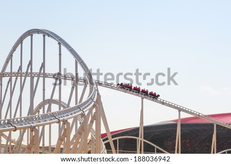 ABU DHABI, UAE - MARCH 27: Roller coaster at Ferrari World on Yas Island in Abu Dhabi on March 27, 2014, UAE. Ferrari World is the largest indoor amusement park in the world. - stock photo