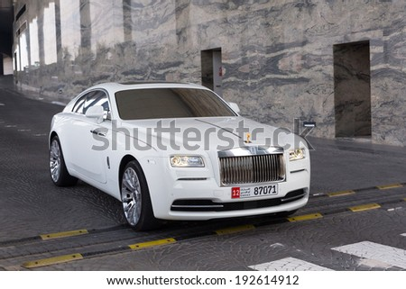 ABU DHABI, UAE - MARCH 29: Rolls-Royce Wraith at the Etihad Towers Hotel in Abu Dhabi on march 29 2014. Abu Dhabi is one of the richest cities in the world with many luxury cars on streets. - stock photo