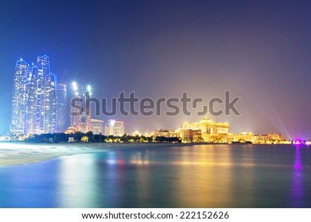 ABU DHABI, UAE - MARCH 28: Skyscrapers of Abu Dhabi at night with Etihad Towers buildings on March 28, 2014, UAE. Abu Dhabi is the capital and the second most populous city of the United Arab Emirates - stock photo